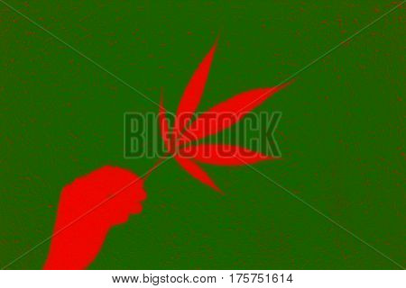 Abstract red marijuana leaf in hand on green and red cracks background