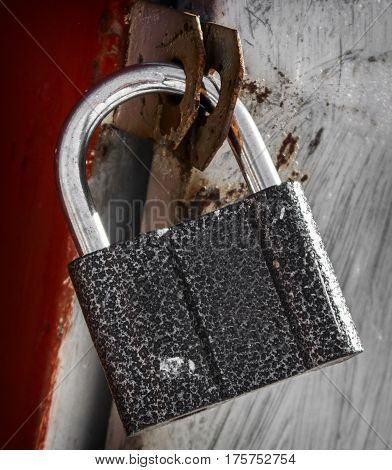 Padlock, new metal padlock on red-gray background, security, metal door