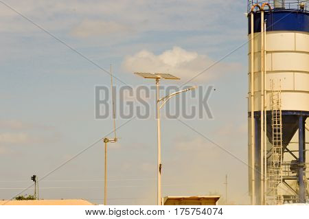 Silos with voltaic panel lighting and a radio antenna in central Kenya
