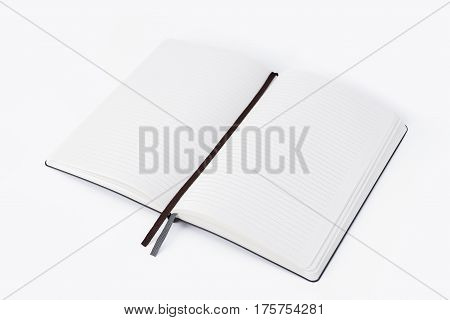 Open blank paper notebook on white background Lighting in the studio