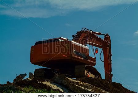 Heavy Earth Mover, Excavator Loader Machine During Earthmoving Works Outdoors