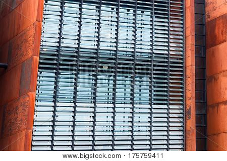 Industrial rusty building with modern windows. Old and new architecture abstract concept.