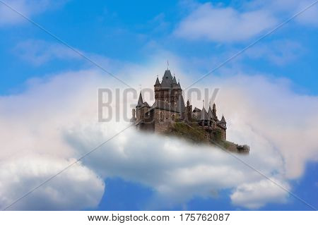 Photomontage of Reichsburg Cochem. Castle in the air Fantasy castle in the clouds