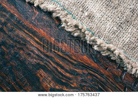 Combination of brown wood and burlap textures. Close-up direct view