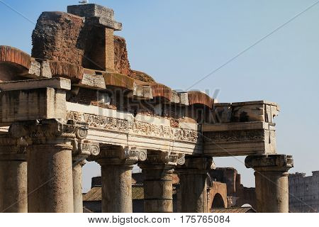 Fragment of ruins of the Temple of Saturn in the Roman Forum in Rome, Italy