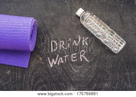 drink more water - hydration reminder - handwriting on On a chalk board. poster