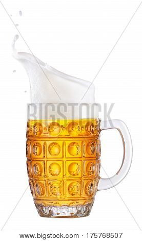 lager beer in mug with splash foam isolated on white background. Beer splash. Glass goblet with beer up. Pub alcohol drink