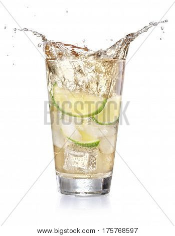 iced lemonade soda in a glass with splashing isolated on white background. Sparkling water with lime and cubes of ice. Cocktail splash from a glass. Splashing beverage. Summer drink with bubbles
