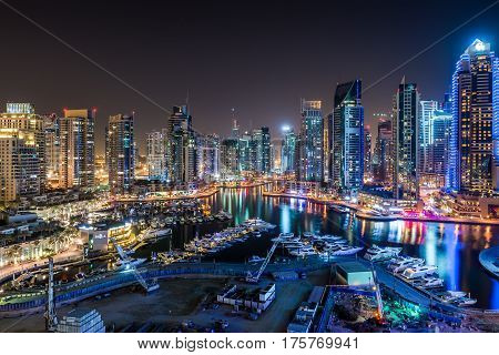 Dubai downtown night scene with city lights, luxury new high tech town in middle East