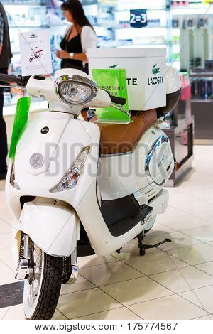 Helsinki Finland - August 5 2012: Fashionable white two-wheeled scooter in style of Lacoste is in pavilion of duty free shop in passenger ferry shipping company Viking Line. Finnish Gulf Suomi