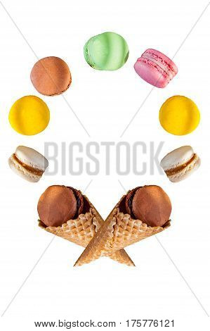 Multicolored Cake Macaron Or Macaroons And Waffle Cones In The Form Of Of Round Frame On The White B