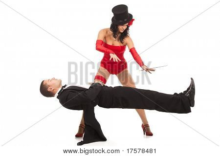 Magic moment - woman performing magically levitating her assistant on white background poster