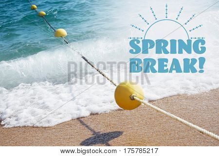 Spring break concept. Yellow buoy with rope on sand beach