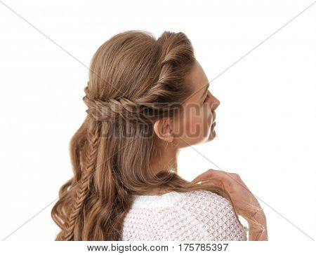 Young beautiful woman with nice braid hairstyle on white background