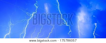 Thunderstorms thunder lightning night sky clouds overcast summer rain background panorama.