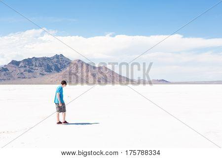 Teenage boy at Bonneville Salt Flats Utah.