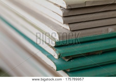 Sheets of plasterboard or drywall (close up) in an apartment during on the renovation and construction