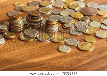 Different Gold And Silver Coins On The Wooden Table
