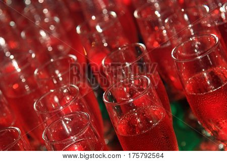 Background of drinking glasses with lemonade, vacation party