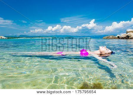 Beautiful Young Woman Swimming In The Wonderful Clean Sea In Greece