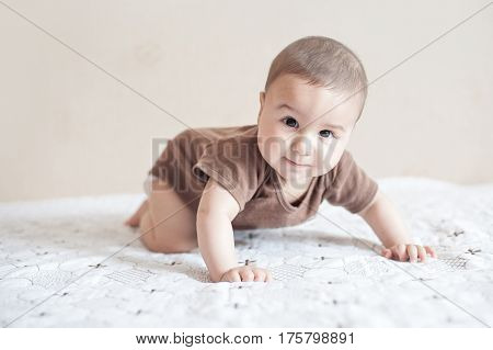 The child is trying to crawl. Cute and adorable newborn baby try crawling