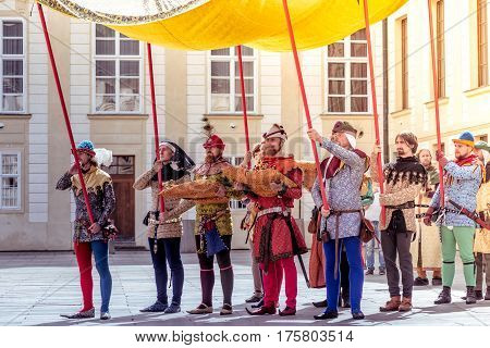 PRAGUE CZECH REPUBLIC - SEPTEMBER 04 2016: Carrying the golden scepter. Re-enactment of the Coronation of Charles IV in Prague Castle.