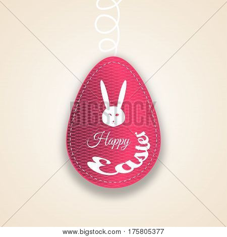 Vector paper label of Easter red egg with line pattern stitching rabbit head white silhouette and text cut from paper on the gradient light brown background.