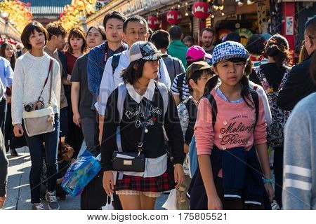 TOKYO JAPAN-October 20: Crowded people heading to the Buddhist Temple Sensoji on October 20 2016 in Tokyo Japan. The Sensoji temple in Asakusa area is the oldest temple in Tokyo.