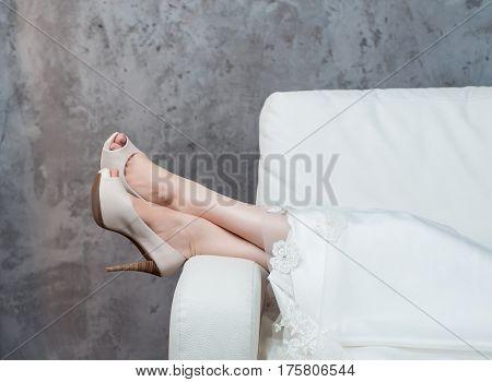 woman's legs shoes in wedding open toes shoes studio. Bride wedding details