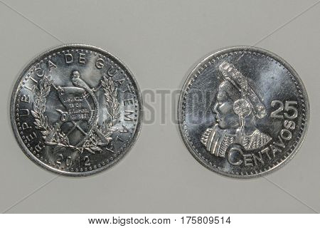 Two faces of a twenty-five cent coin of Quetzal (Guatemalan currency)