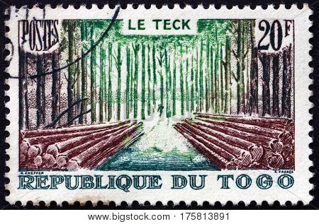 TOGO - CIRCA 1957: a stamp printed in Togo shows Teak Forest circa 1957