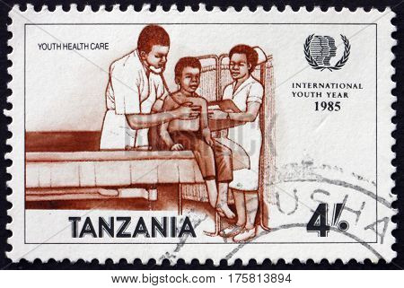 TANZANIA - CIRCA 1986: a stamp printed in Tanzania shows Doctor and Patient Youth Health Care circa 1986