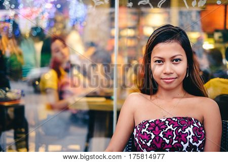 Young beautiful woman chilling outside the coffee-shop