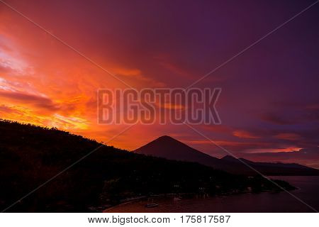 Red sunset and volcano Agung in Bali