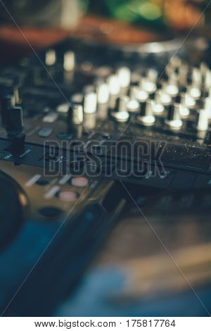 professional mixing controller at the beach ** Note: Shallow depth of field