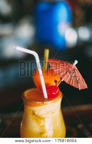 Summer drink orange shake with cherry in the glass