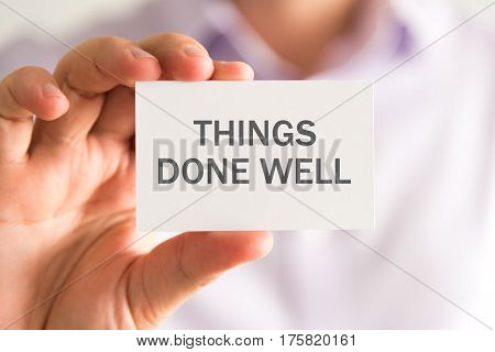 Businessman Holding A Card With Things Done Well Message