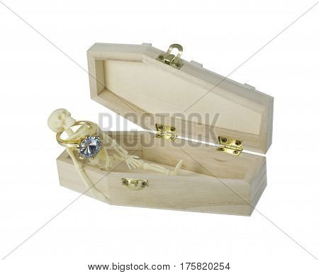Skeleton wearing Diamond Engagement Ring lying in a Coffin - path included