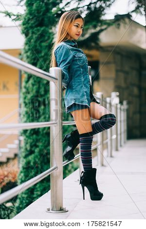 Fashionable pretty young woman wearing striped knee socks
