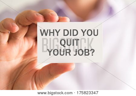 Businessman Holding A Card With Why Did You Quit Your Job ? Message