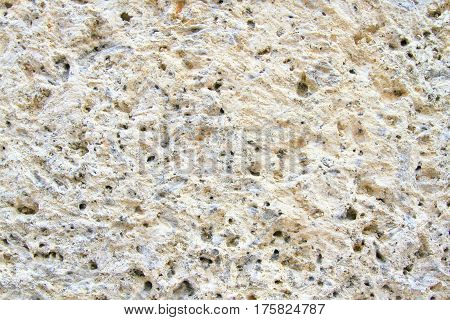 Rough concrete wall texture with small holes