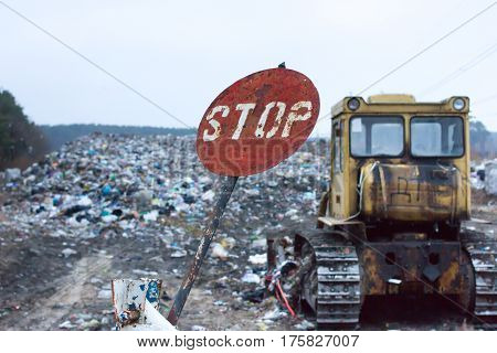 Red round stop sign, indicating that garbage at this dump has long denied. Landfill works. Lviv waste. Problem of waste disposal.