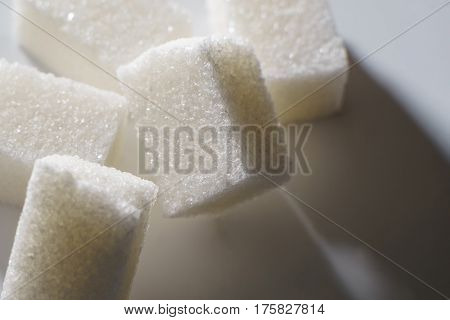 refined sugar closeup on a white background.