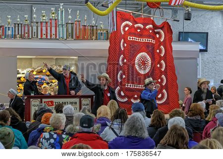 GORDONVILLE PENNSYLVANIA - March 11 2017: Amish volunteers help at the annual quilt auction to benefit the Fire Company.