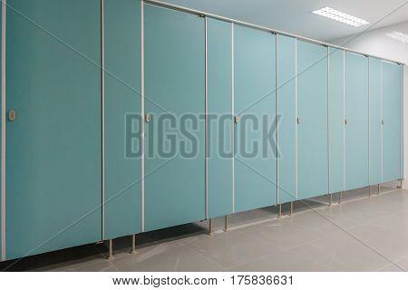 Clean men public toilet room empty with big window interior.