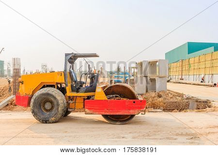 soil vibration roller during sand compacting works at construction site