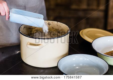 Closeup of the hands of men to knead the dough for bread.