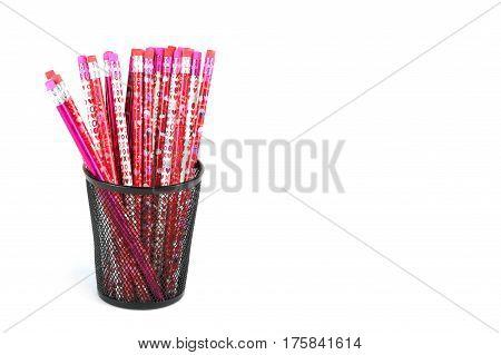 colorful pencils in the metal pen pot