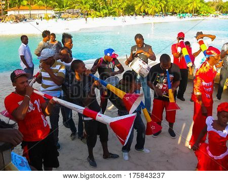 Boca Chica, Dominican Republic - February 12, 2013: Resident people celebrate Caribbean Carnival on the Beach
