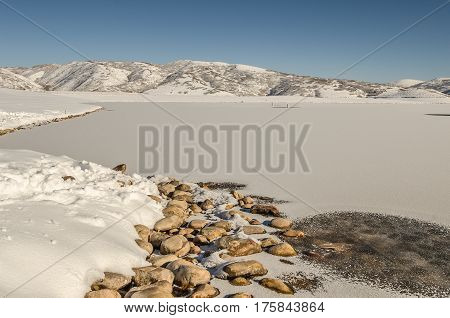 Mostly frozen Jordanelle Reservoir in Wasatch County Utah